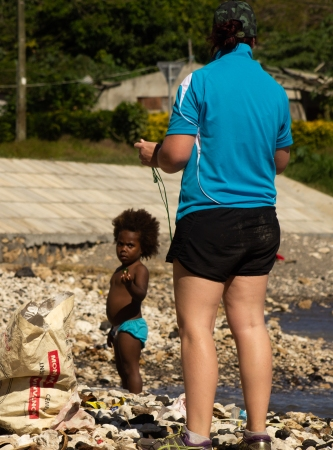 Ness started to pick up rubbish, and the girl joined in.