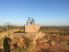 Huge car-sized slabs of granite, which will never see a kitchen, lie scattered around the old granite mine outside Mt Isa.